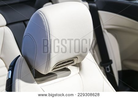 Modern Luxury Car Perforated Stitched White Leather Interior.part Of Leather Car Seat Details. Moder