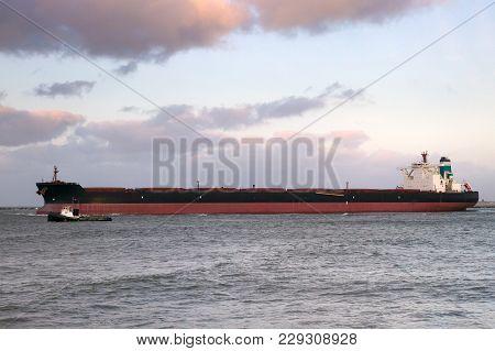 Large Oil Tanker Leaving The Port Of Rotterdam.