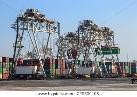 Rotterdam, Netherlands - Sep 8, 2012: Automated Guided Vehicles Moving Shipping Containers In A Cont