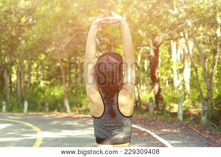 Healthy Young Woman Exercising In Sunny Bright Light. Sport Exercise Concept.