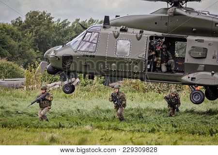 Beauvechain, Belgium - May 20, 2015: Soldiers Disembark From An Army Nh90 Helicopter.