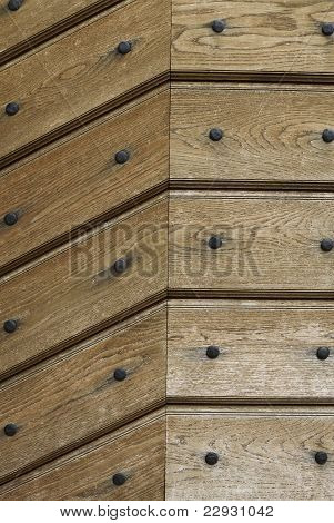 wooden background or texture with iron rivets
