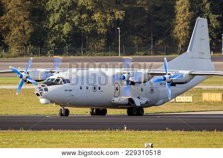 Eindhoven, The Netherlands - Oct 27, 2017: White Russian Antonov An-12 Cargo Plane Taxiing On Eindho