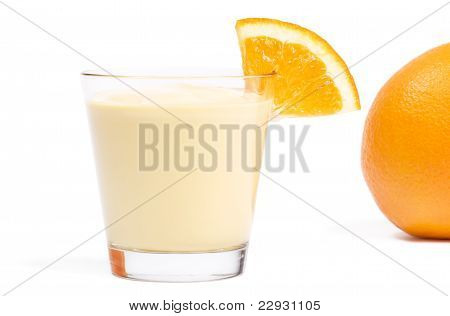milkshake with a piece of orange and orange in back