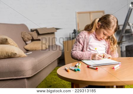 Cute Little Child Drawing With Felt Tip Pens At Home