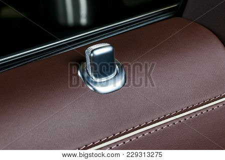 Door Handle With Lock Contol Buttons Of A Luxury Passenger Car. Red Leather Interior Of The Luxury M