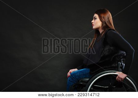 Sad Girl Sitting On Wheelchair. Disabled Depressed Woman. Health Medical Disability Rehabilitation C