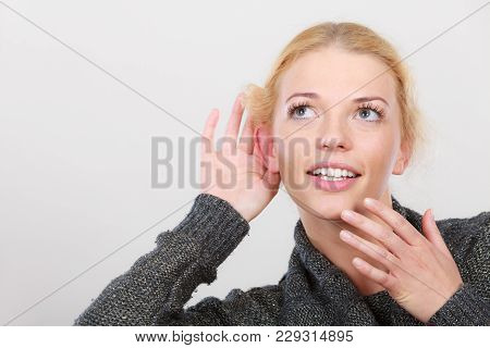Gestures, Gossip And Rumors, Hearing Loss Or Disorder. Woman Put Hand To Ear For Better Hear Having
