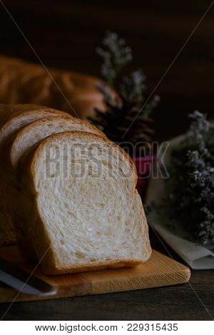 Sliced Soft And Sticky Delicious White Bread On Wood Cutting Board Prepare Bread For Breakfast On Wo