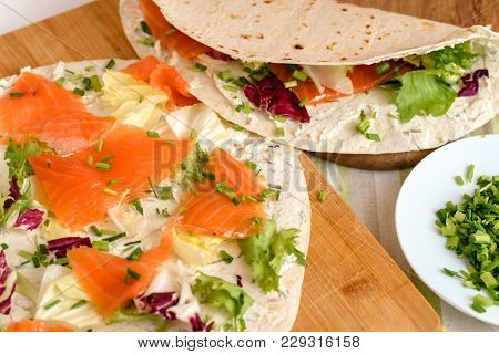 Pancakes With Smoked Salmon, Cream Cheese, Chives And Lettuce.