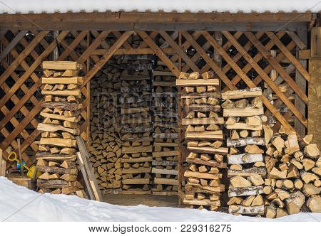 Rustic Barn For Storage Of Firewood, Stacked Firewood