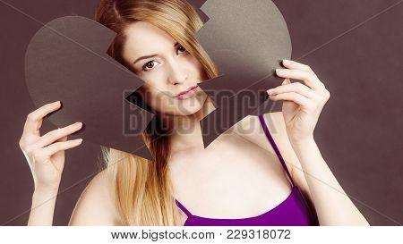 Sad Young Woman With Black Broken Paper Heart. Negative Sad Emotions, Relationship Problems Concept,