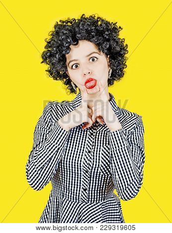 Excited Happy Woman In Afro Wig Making Funny Grimass, Isolated On Yellow Background