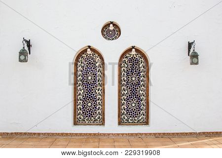 Two Decorative Niches And Lanterns On White Building In Egypt