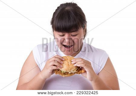Fat Asian Woman Eating Fried Chicken Hamburger Isolated On White. Food And Healthcare Concept