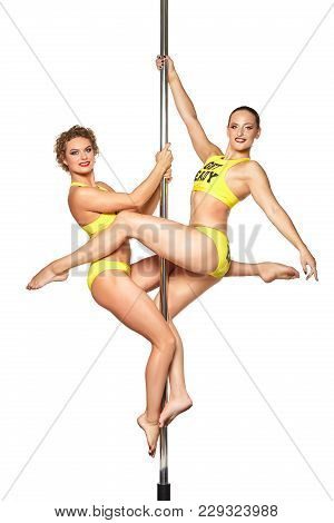 Two Beautiful Young Women Pole Dancers In Yellow Costumes With Get Ready Text On Them Training On Py