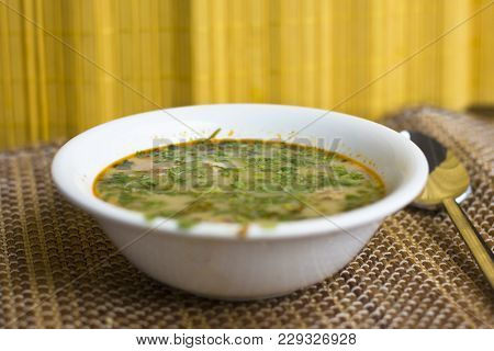 Spicy Soup Tom Yam With Shrimps And Greens