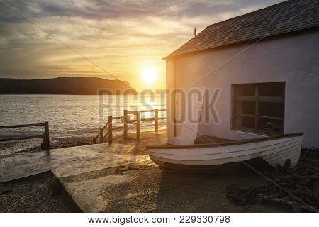 Beautiful Vibrant Sunrise Landscape Over Lulworth Cove In Dorset