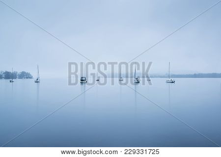 Foggy Morning Landscape Over Lake Windermere In Lake District In Autumn