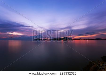 Long Exposure Image Of Dramatic Sunset Or Sunrise,sky Clouds Over Tropical Sea