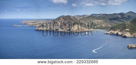 Landscape View Off Cliffs On Ibiza In Vibrant Summer Sun