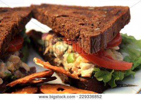 Chicken Salad Sandwich on Multi Grain Bread. Lunch concept. Isolated on white with room for text. Chicken Salad on bread.