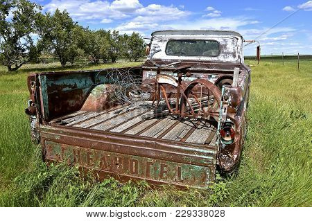 Firesteel, South Dakota, June 22, 2017: The Tailgate Of An Old Pickup Loaded With Junk Is A Chevrole
