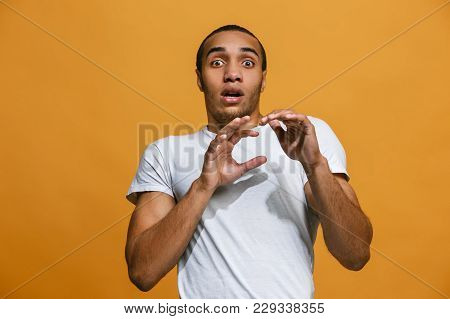 Portrait Of The Scared Man On Orange