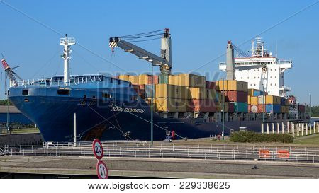 Rotterdam - Jul 9, 2013: Ship Moving Through A Lock Sluice To Leave The Port Of Rotterdam.