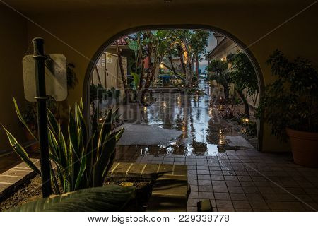 Rainy Morning Wets The Path Outside Arch Entrance To Ventura Harbor Village On March 3, 2018 In Cali