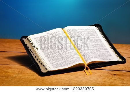 Image Of Book The Bible Open Antique Book On Wooden Table With Glitter Background