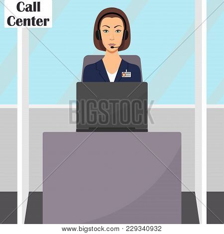 Woman In Headphones With Microphone Sitting At Her Desk With Laptop Computer. Operator Of Call Cente