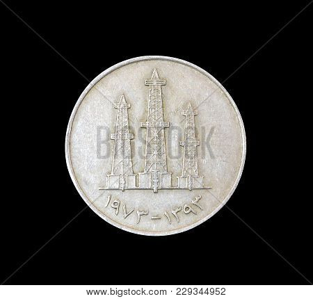 Reverse Of Vintage Coin Made By United Arab Emirates That Shows Oil Derricks