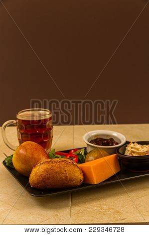 Ploughman's Lunch With Red Leicester Cheese And Half Pint Of English Beer.