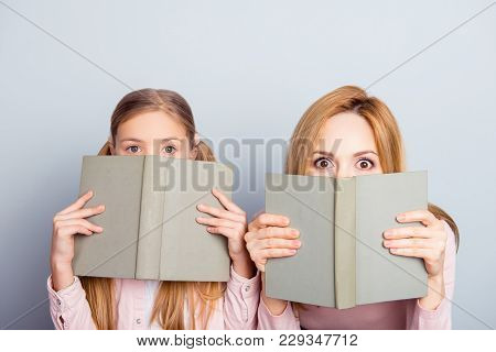 Astonished Reaction Of Mother And Daughter Close Half Face With Books, Looking Out, Wide Eyes, Impre