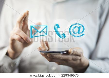 Businessman Hand Phone  With Message,phone And @mail Mark In Screen