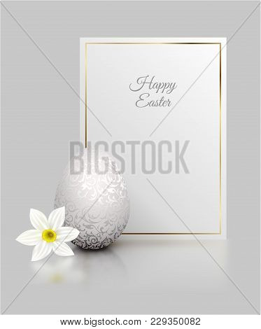 White Color Realistic Egg With Silver Metallic Floral Pattern And Happy Easter Card Golden Frame. Wh