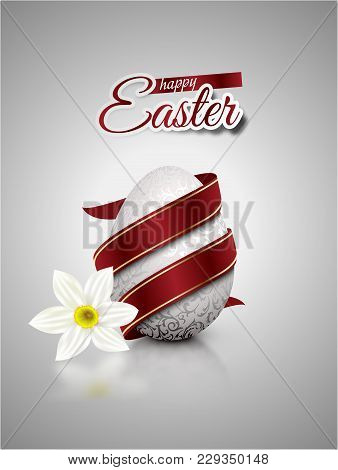 White Realistic Egg With Silver Metallic Floral Pattern Diagonal Wrapped Red Ribbon. Gray Background