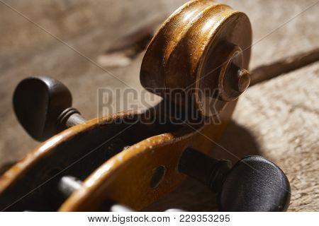 Old Vintage Instrument Lieing On Wooden Background