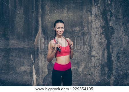 Great Job! Happy Young Sport Woman In Stylish Training Outfit With Jumping Rope On Her Shoulders Is