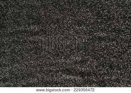 Abstract Glitter Lights Background. De-focused. Silver Background