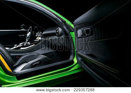 Modern Luxury Sport Car Inside. Interior Of Prestige Car. Black Leather Seats With Yellow Stitching.