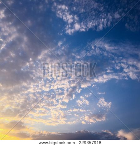 Deep Blue Sunny Sky With White Clouds. Blue Sky With Cloud Close-up. White Fluffy Clouds In The Blue