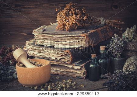 Tincture Bottles, Bunches Of Dry Healthy Herbs, Stack Of Antique Books, Mortars, Sack Of Medicinal H