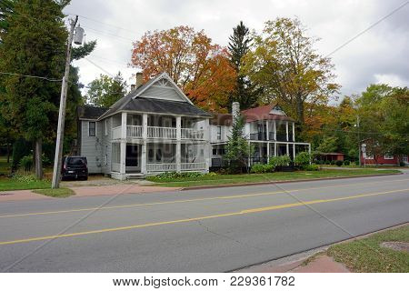 Bay View, Michigan / United States - October 16, 2017:  A Pair Of Large Two Story Victorian Cottages