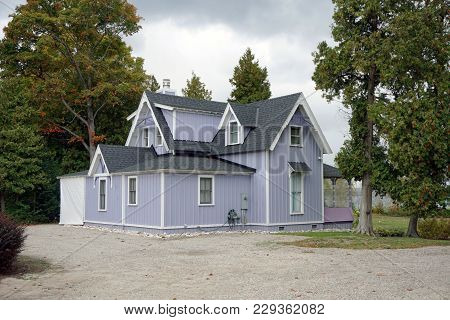A Purple Two Story Cottage, Near The Lake In Bay View, Michigan, During October.