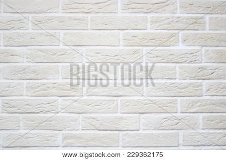 Texture Of Light Beige Scratched Relief Brick Wall With White Seams And Rectangular Bricks From Deco