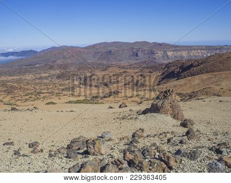Desert Volcanic Landscape On Tenerife With Purple Mountains In El Teide National Nature Park With Hu