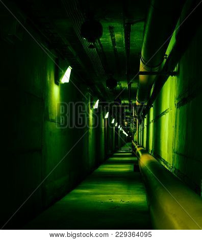 Psychedelic Green Deep In Underground Tunnel. Colored Industrial Background. Emergency Lighting, Row