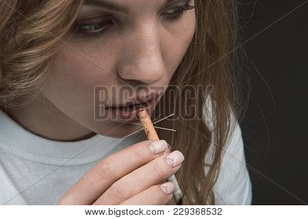 Close Up Of Serene Female Face Going Smoking Thorny Coffin Nail. Isolated On Background
